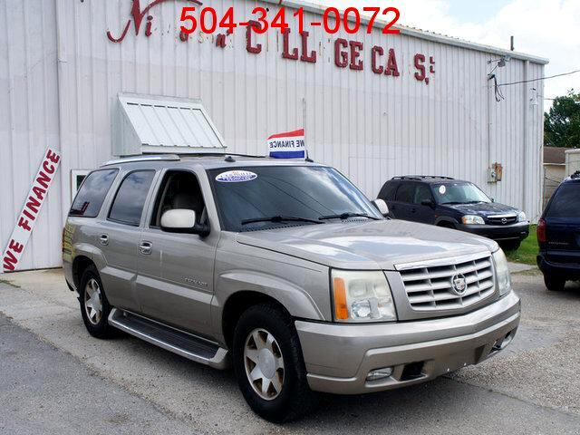 2003 Cadillac Escalade DO YOU HAVE A JOB ARE YOU OVER 18 DO YOU HAVE AN ID WELL AS LONG AS YOU