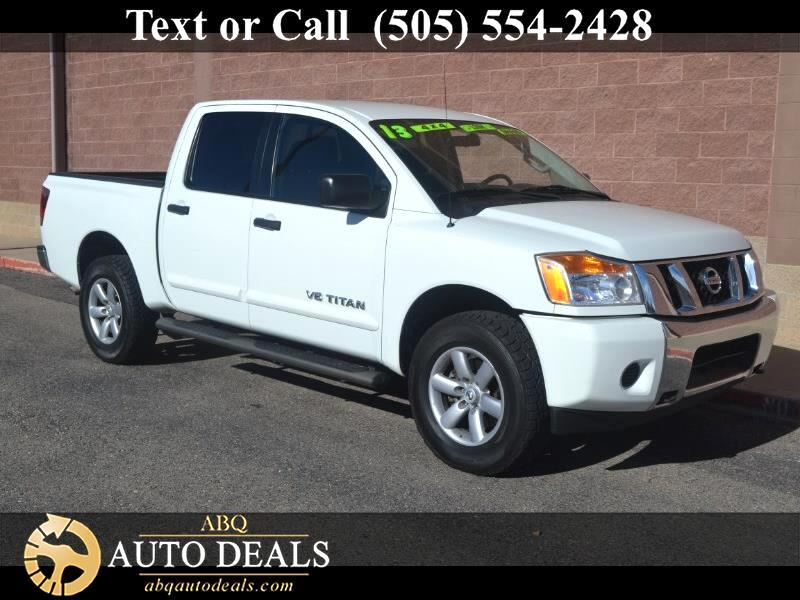2013 Nissan Titan Our 2013 Nissan Titan SV Crew Cab 4X4 offers enormous size strength power and inf