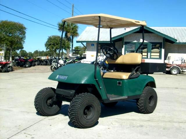2002 EZGO Golf Cart Lifted Electric powered with charger works good