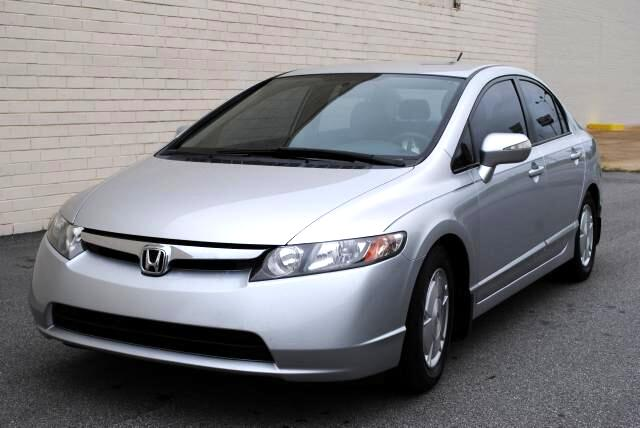 2006 Honda Civic Hybrid At Olympic Auto Sales we strive to provide select pre-owned luxury cars that