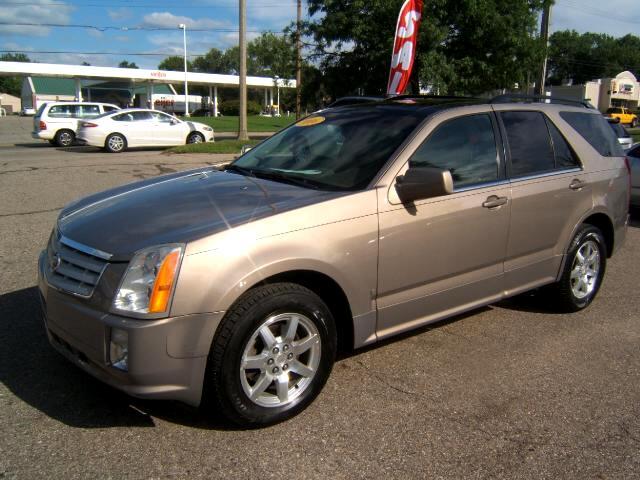 2006 Cadillac SRX has a panoramic moon roof leather interior cd player power windows locks tilt crui