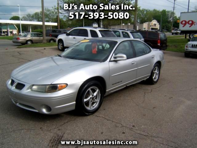 2002 Pontiac Grand Prix a one owner clean car runs and drives good some rust on the rocker panels