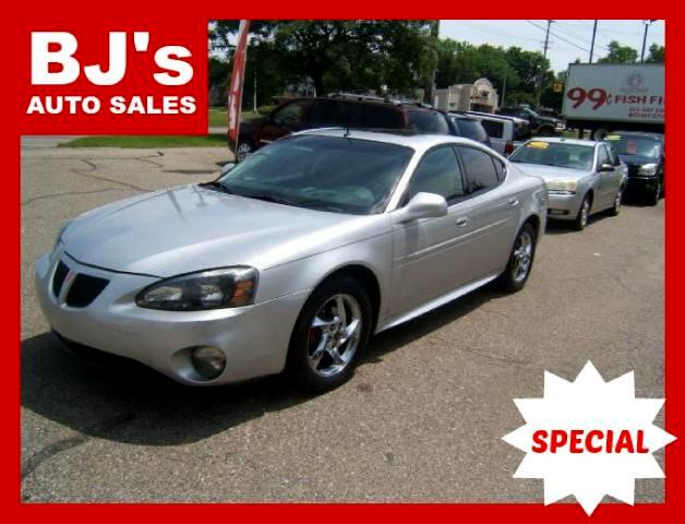 2004 Pontiac Grand Prix has a 3800 engine moon roof cd player leather power mirrors windows locks t