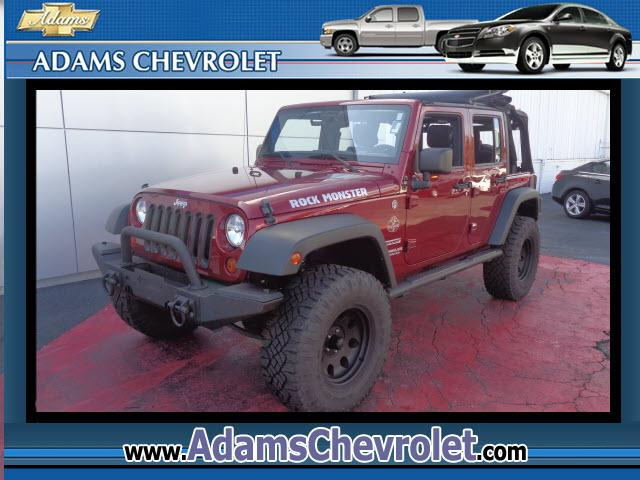 2013 Jeep Wrangler Clean Auto Check 5-Speed Automatic and Flame Red Clearcoat This ride will leave