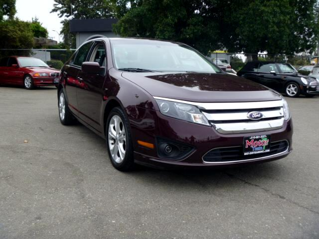 2012 Ford Fusion Extended service Plan And Finance Available Please bring this ad with you to get t