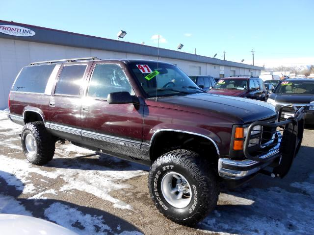 1997 GMC Suburban GREAT RUNNING LIFTED BAD BOY THAT IS READY TO GO CLOTH LOADED WITH NICE WHEELS