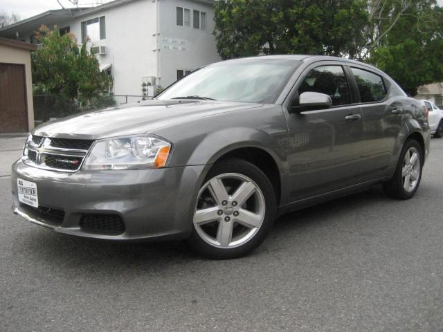 2013 Dodge Avenger This 2013 Dodge Avenger SXT Sedan is Charcoal with Black Interior and is an ONE O