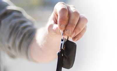 Person handing over keys after selling their vehicle to Full Throttle Auto Sales in Tacoma, Washington 98444