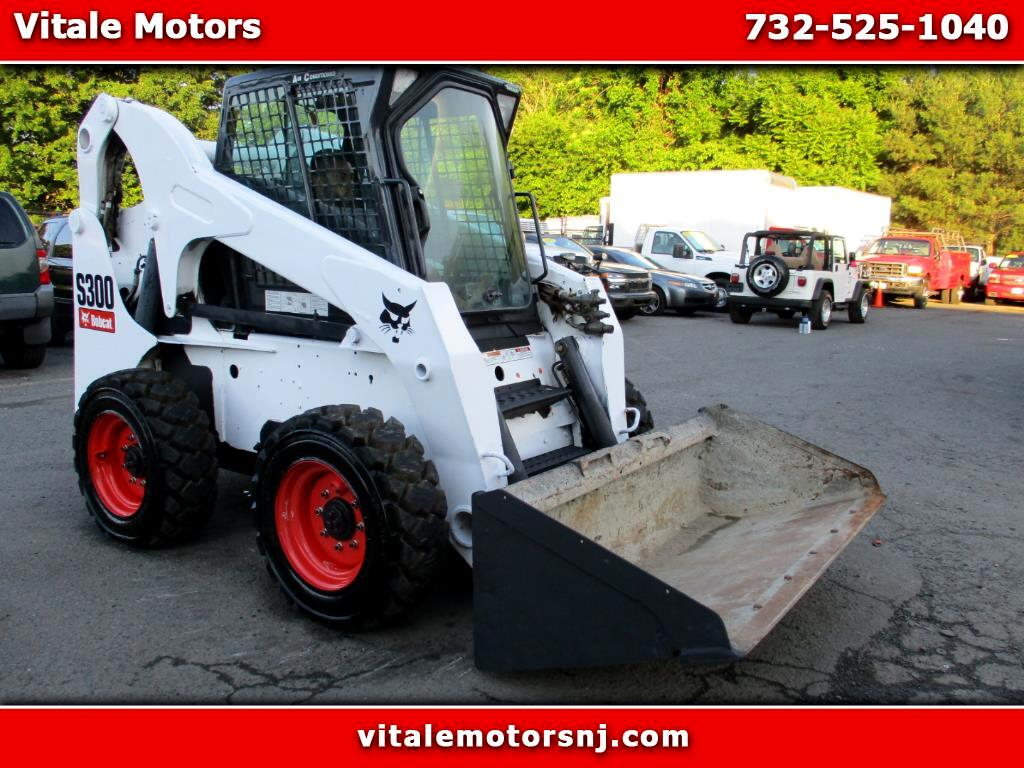 2004 Bobcat S300 SKID STEER WITH A/C + NEW RUBBER