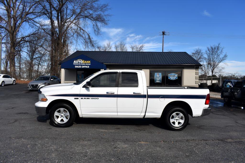 "Dodge 1500 4WD Quad Cab 140.5"" SLT 2011"