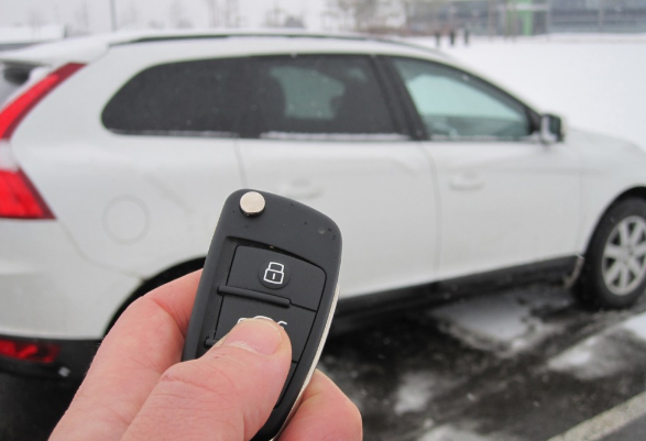 Car in snow being started by remote car starter